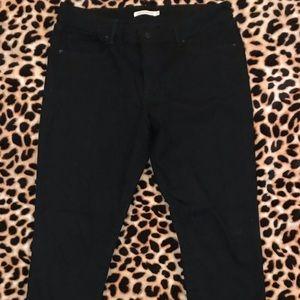Women's black mid rise skinny Levi's jeans 14